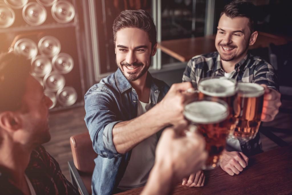 men having drinks in a bar