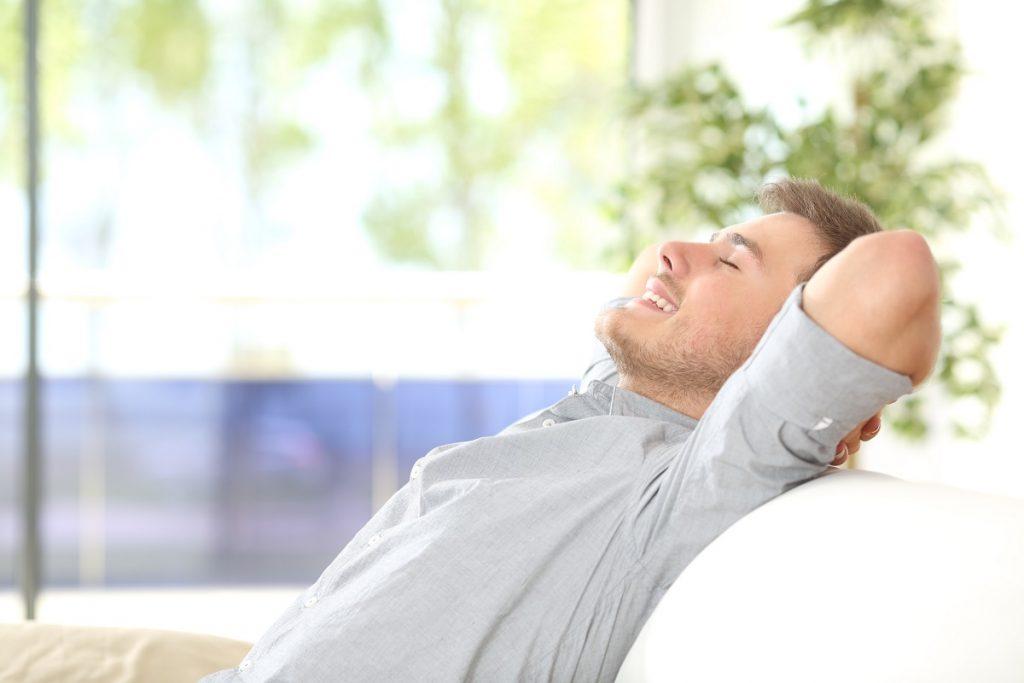 Guy resting at the hostel lobby