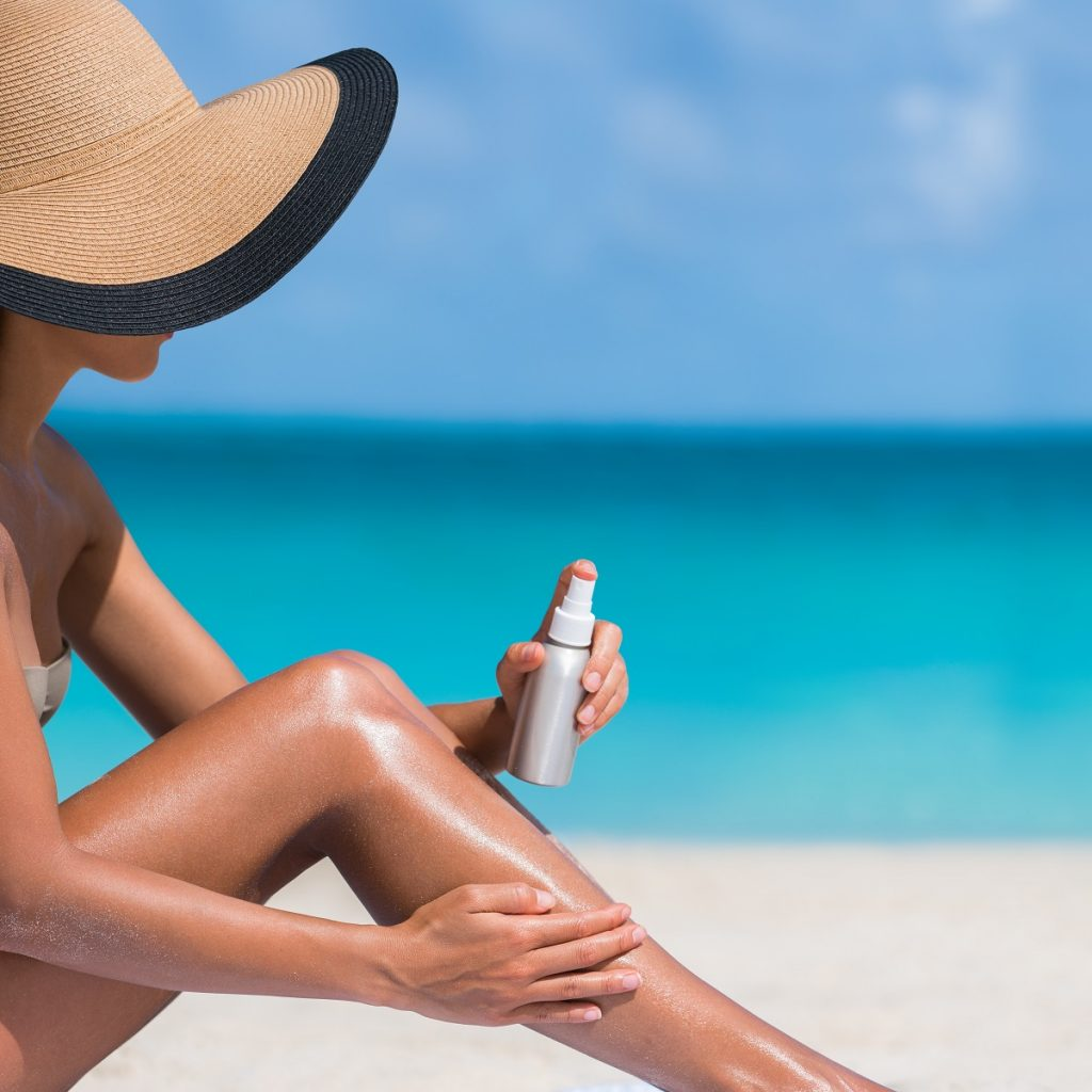Woman applying sunscreen lotion