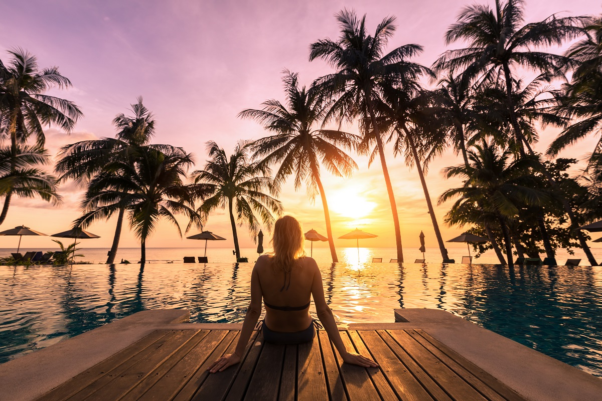 Woman enjoying the sunset near the ocean
