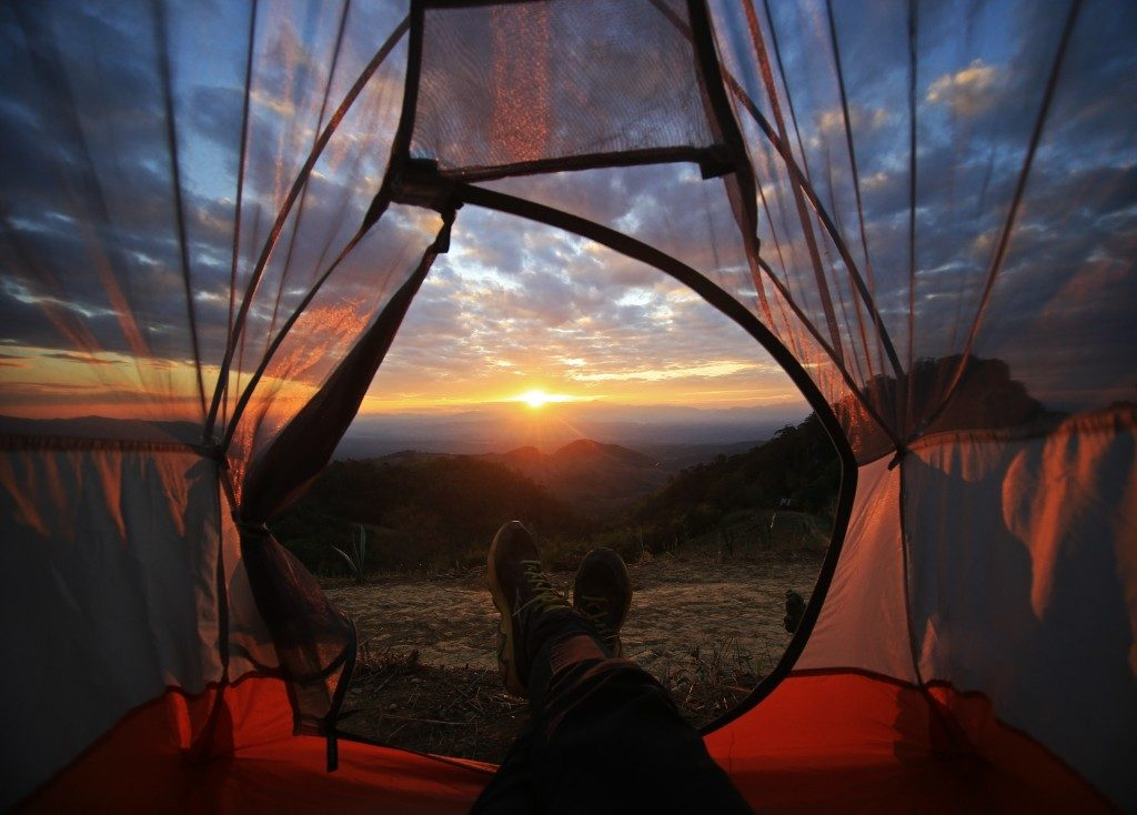 Person in the tent enjoying the sunset