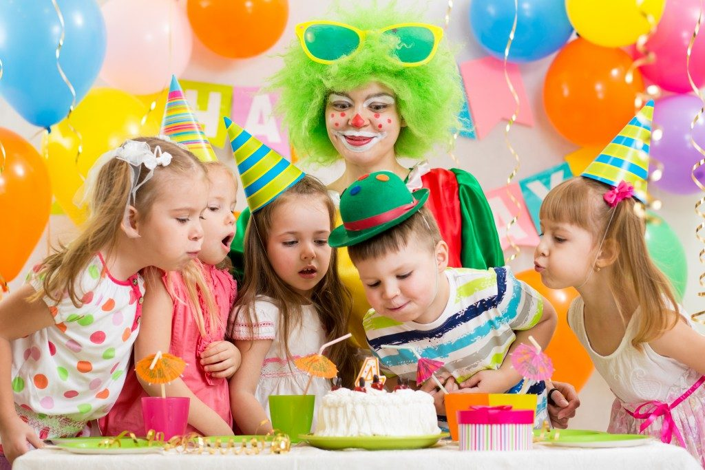 Children's birthday party celebration with birthday cake