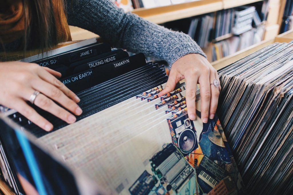 woman choosing vinyl records