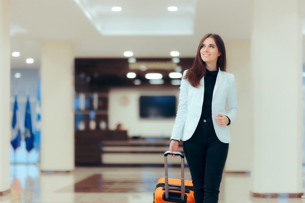 woman pulling her luggage
